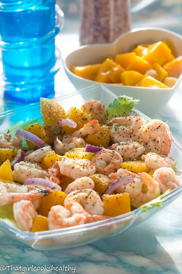 Prawn and mango salad with a bowl of mango in the background