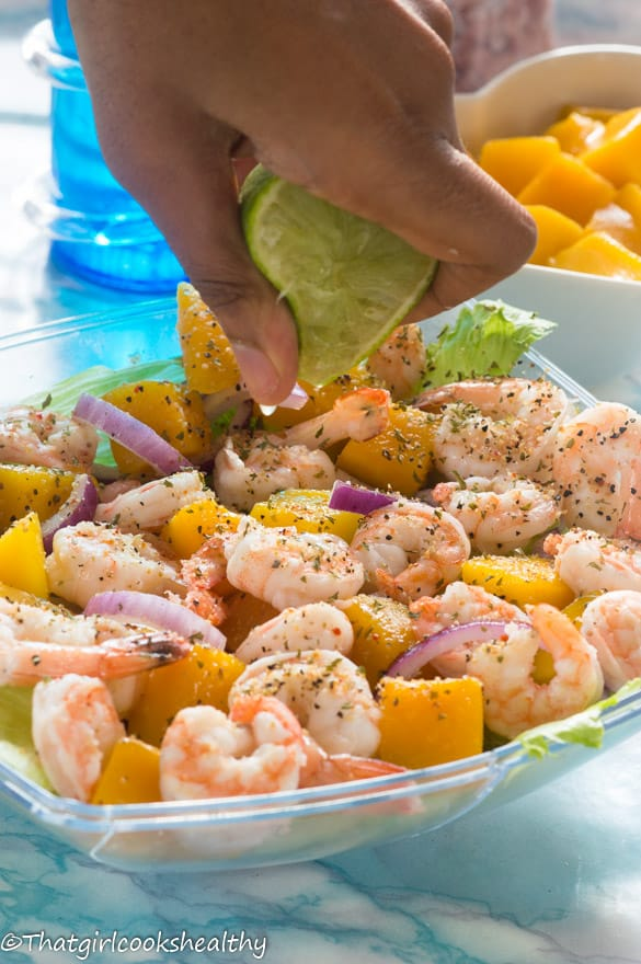 Squeeze lime on the prawn and mango salad