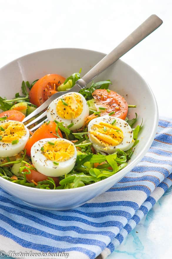 egg salad in an oval bowl with a fork