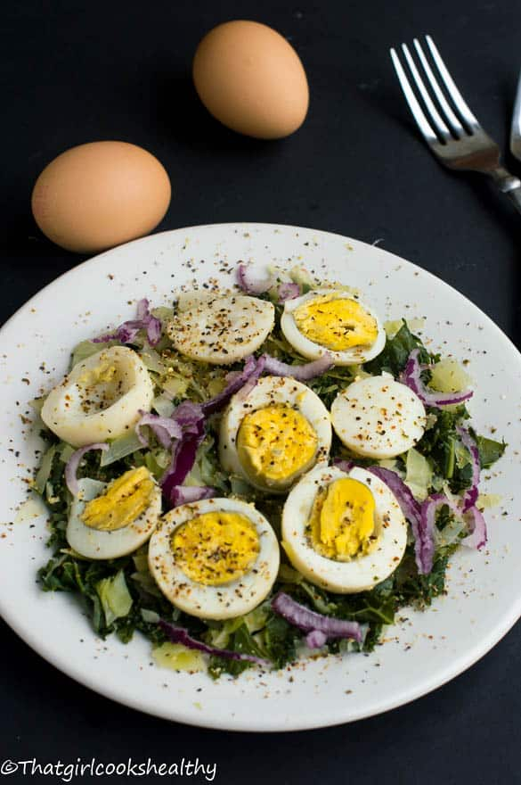 Boiled eggs with curly kale