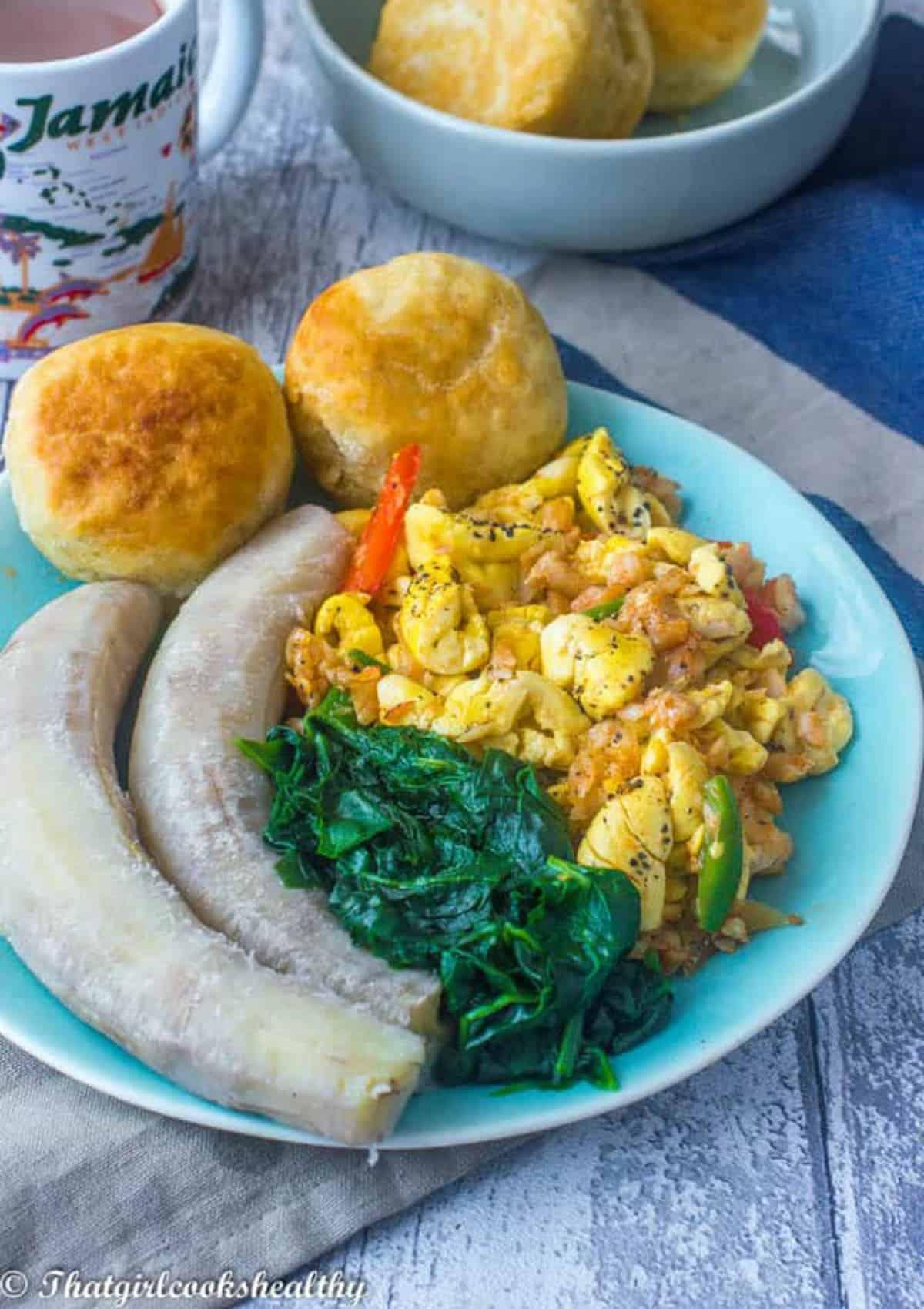 Ackee. saltfish, callaloo and green banana on one plate