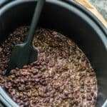 Slow cooker black beans with spatula