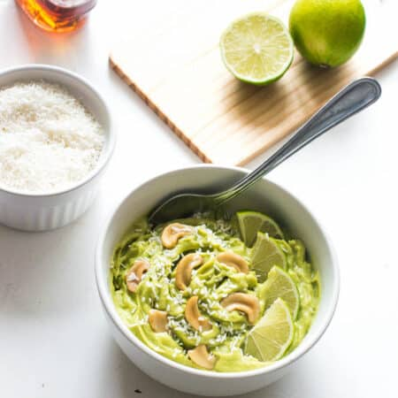 key lime pudding in a bowl with coconut and cashew nuts