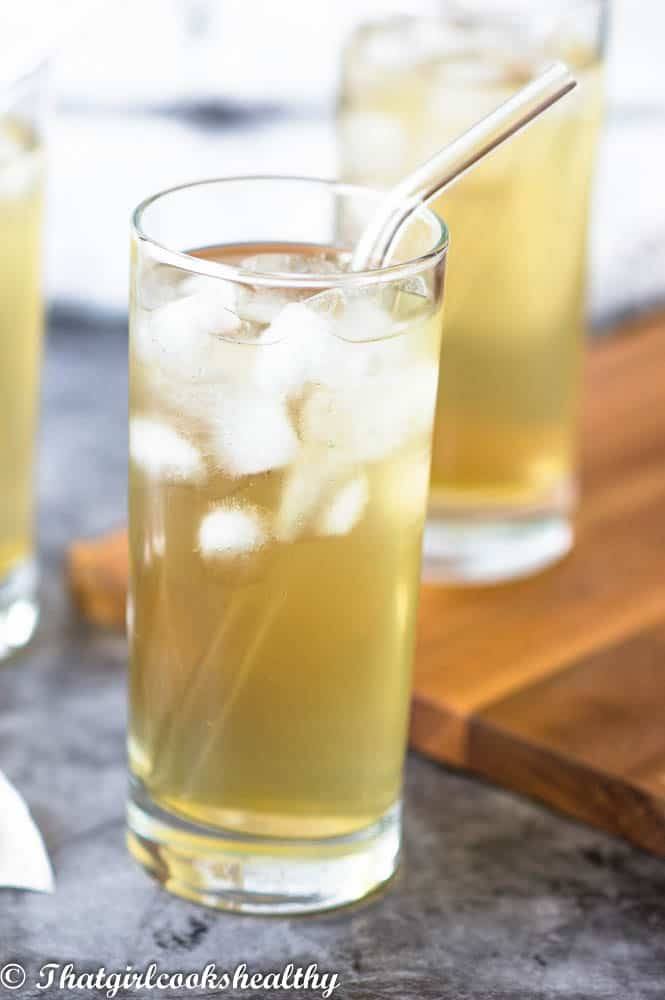 Close up of Iced cerasee tea with a clear straw