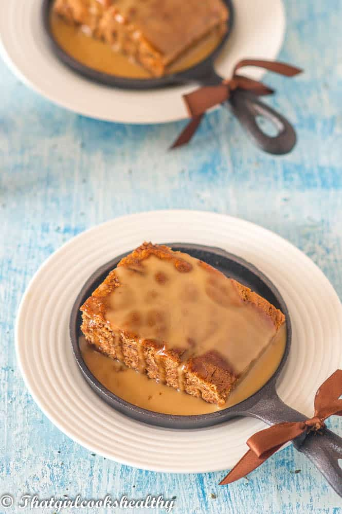 pudding in a skillet with brown bow