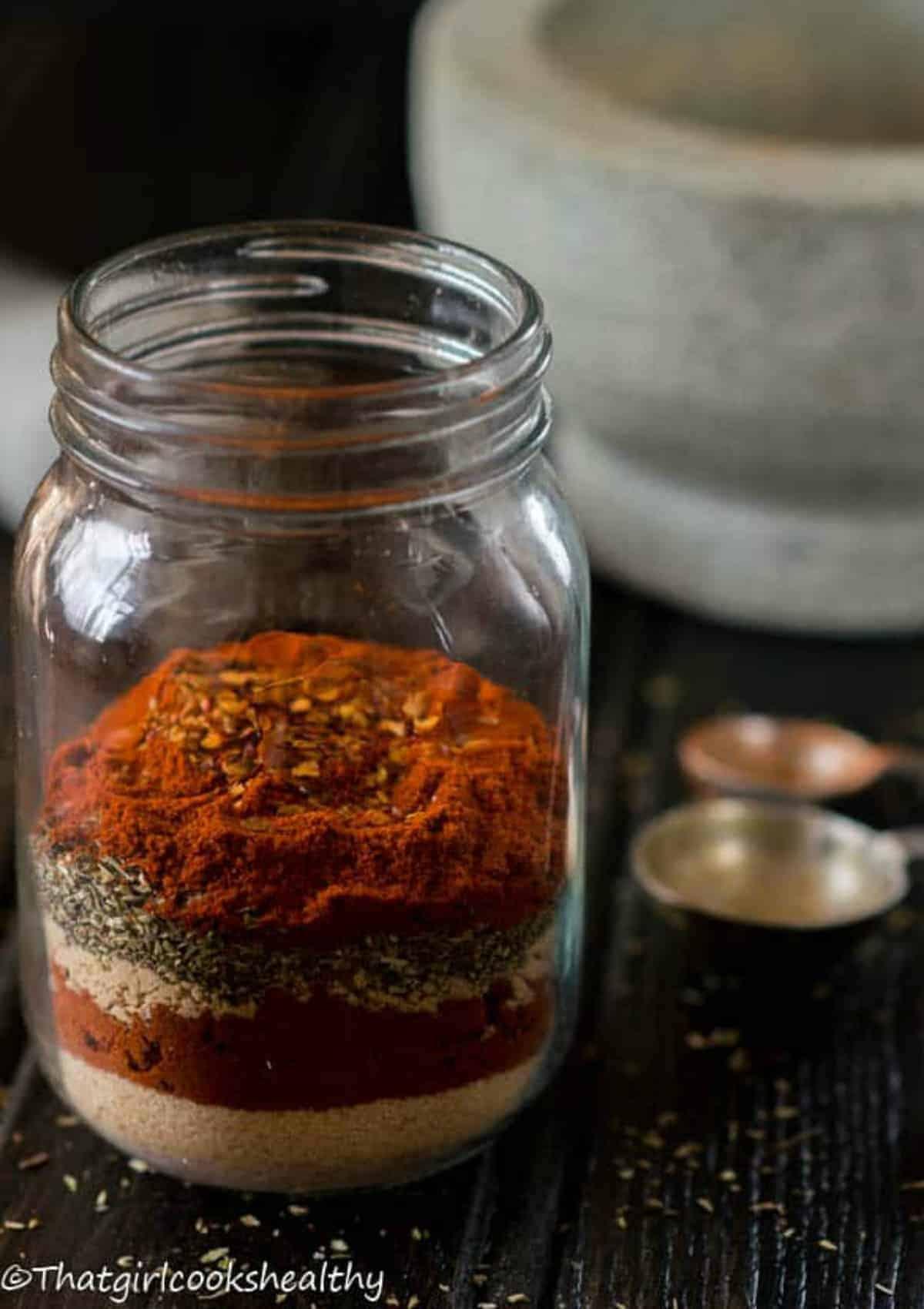 seasoning in a jar with spoon