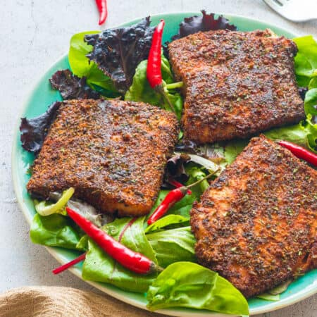 Red chillis with the fillets of salmon