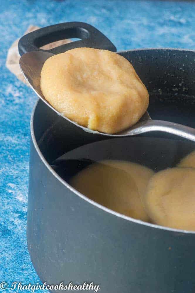 Dumpling on a slotted spoon