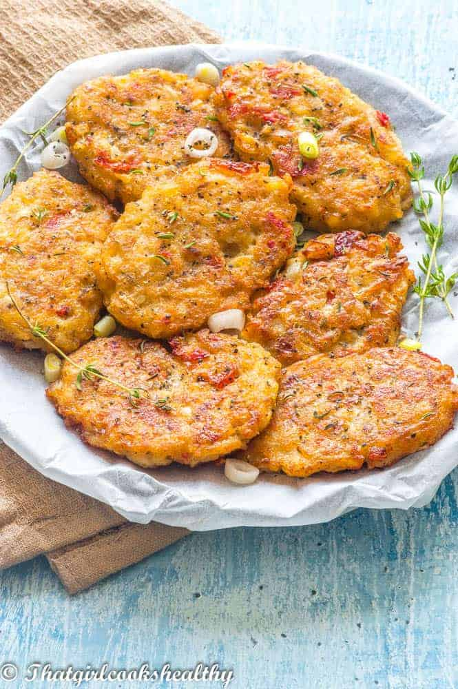 Fritters on a plate with white paper