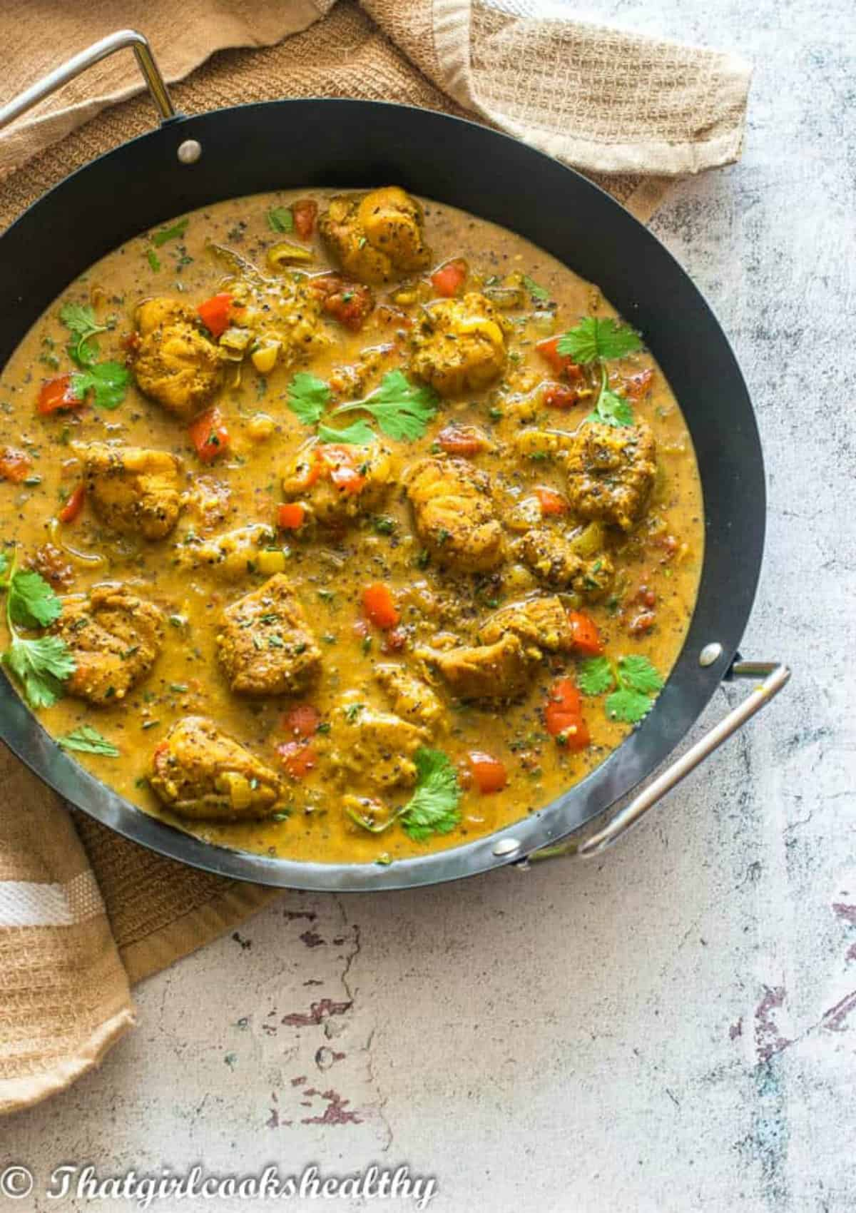 cod curried in a black skillet