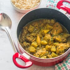 Curry chicken in a red pot