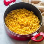 Sweet potato mac and cheese in a red pot