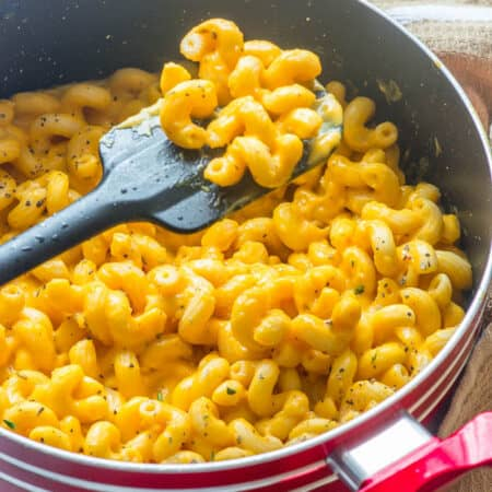 Spatula scooping up some macaroni