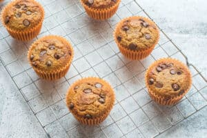 five muffins on a cooling rack