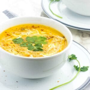 soup in a white soup on a side dish