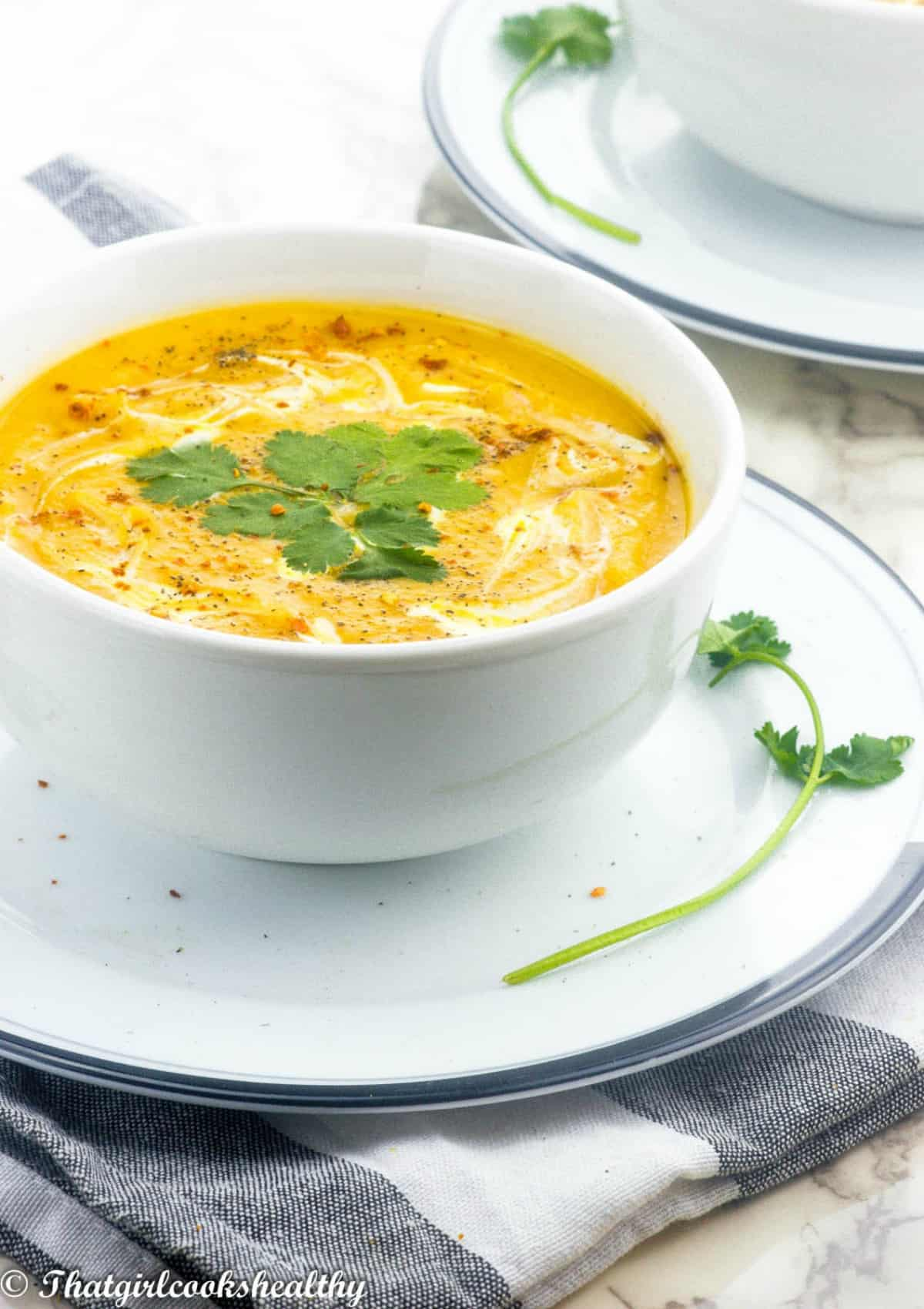 Close of the soup with topped with herb