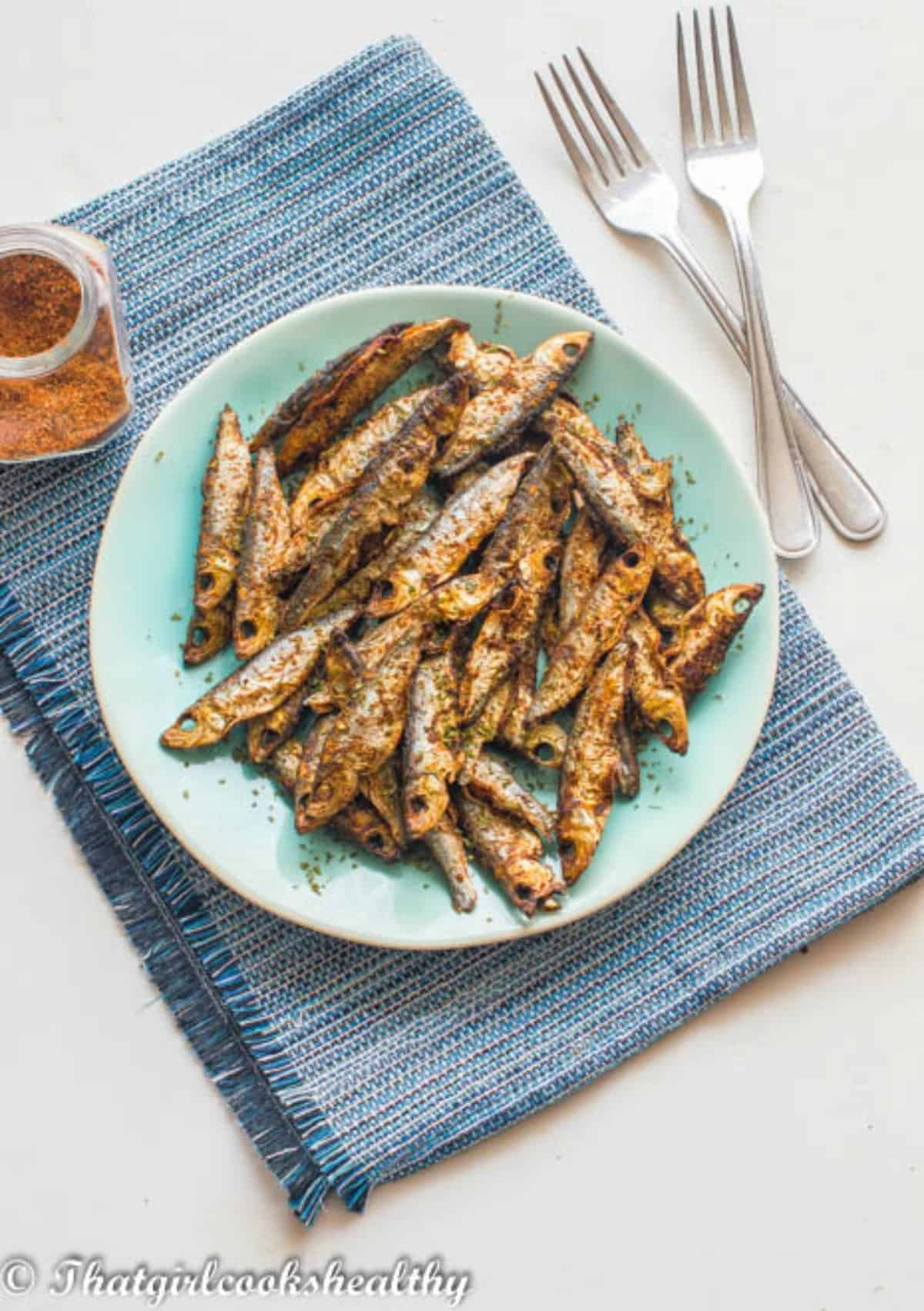 Sprats on a blue plate