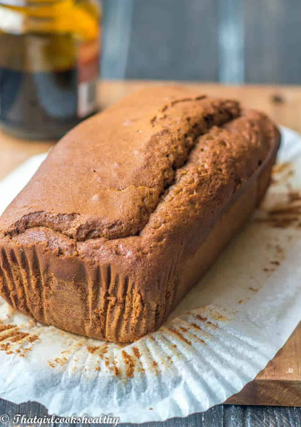 unsliced cake, liner removed with molasses