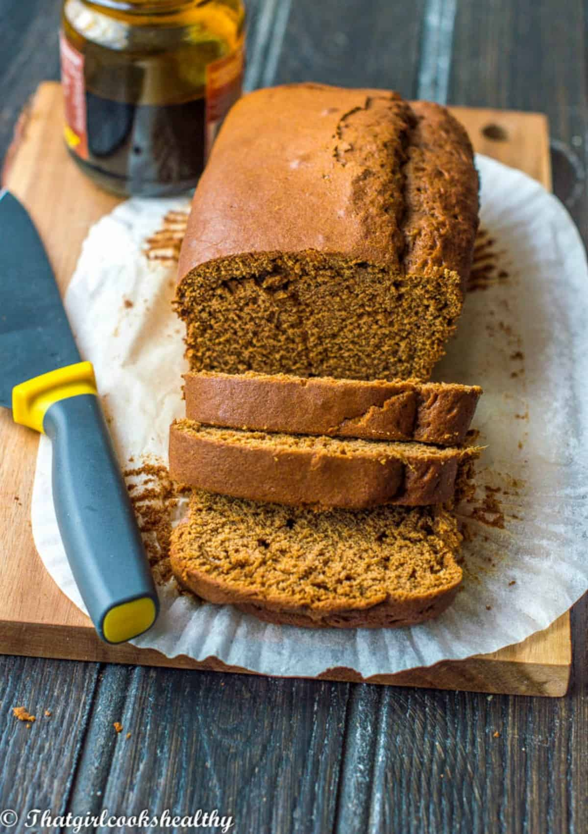 Cake on a brown broad with knife