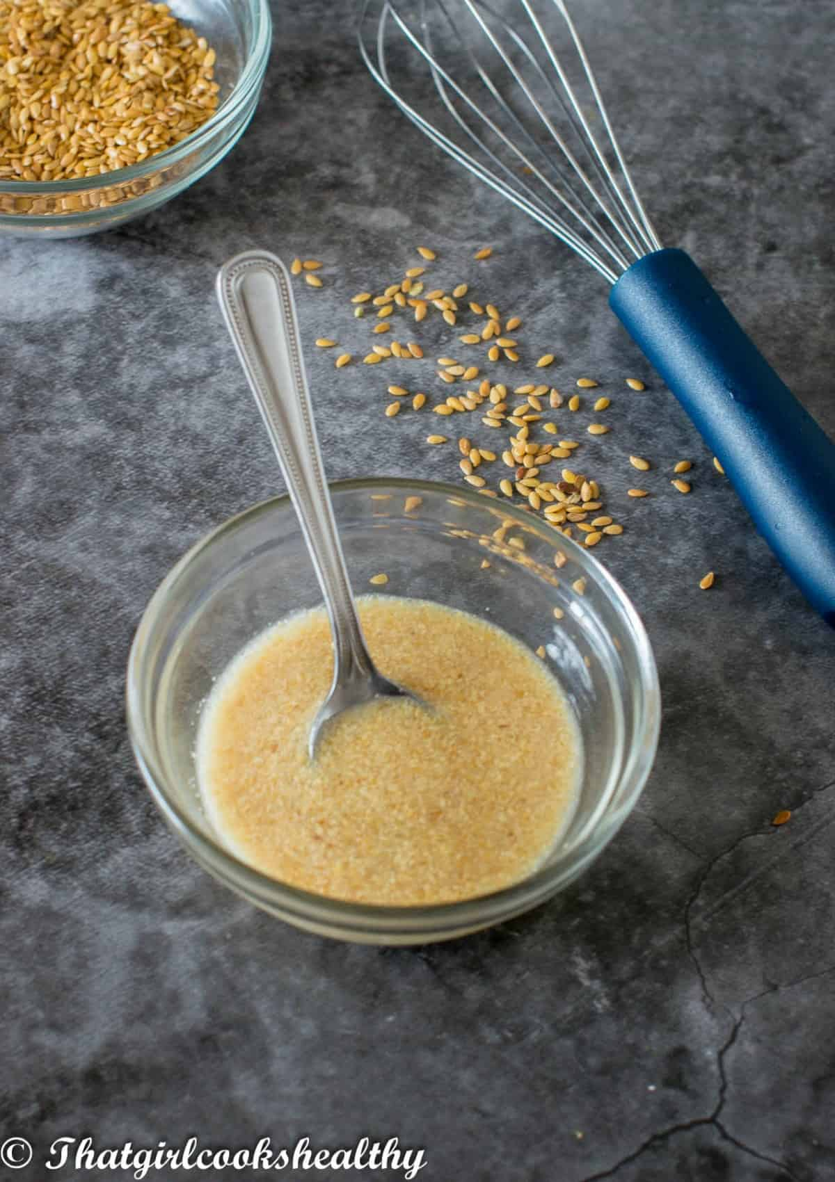 flaxseed with a whisk at the side