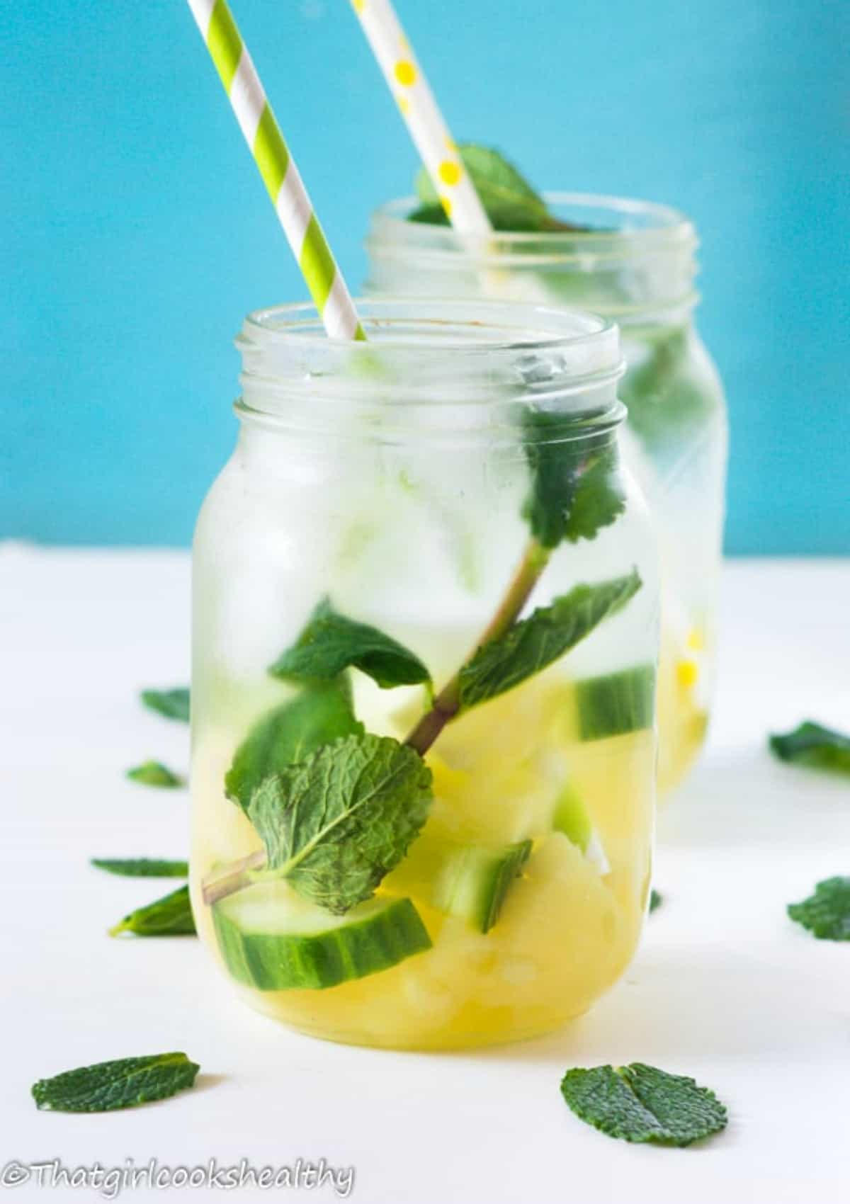 water with pineapple chunks and mint in a jar