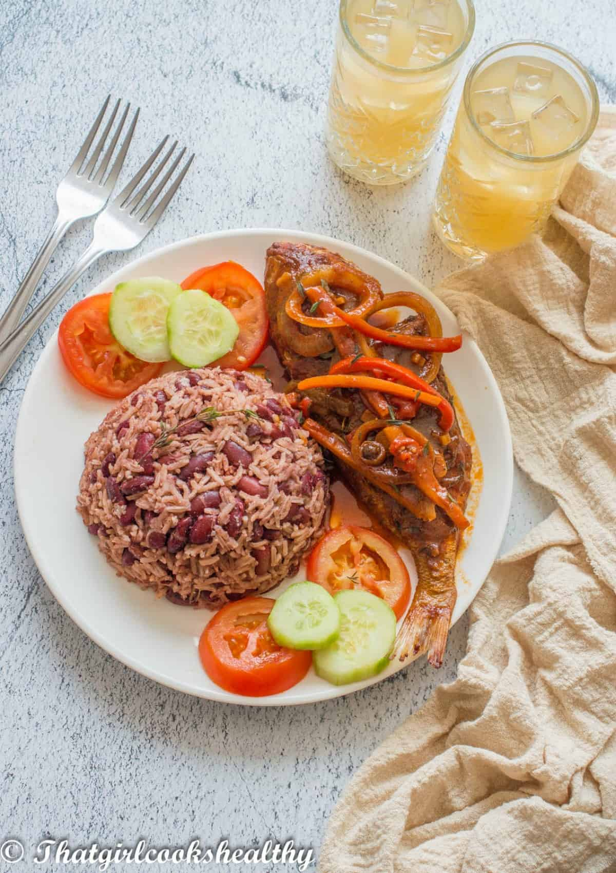 stewed fish on a plate with rice
