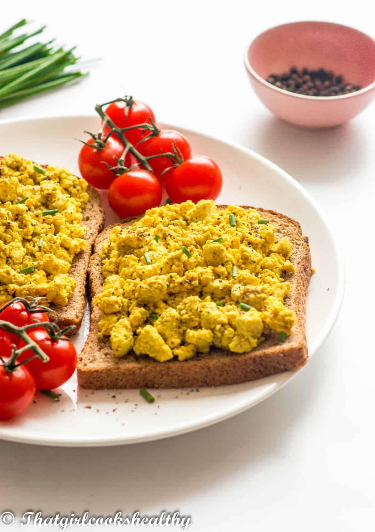 tofu scramble on toast with tomatoes