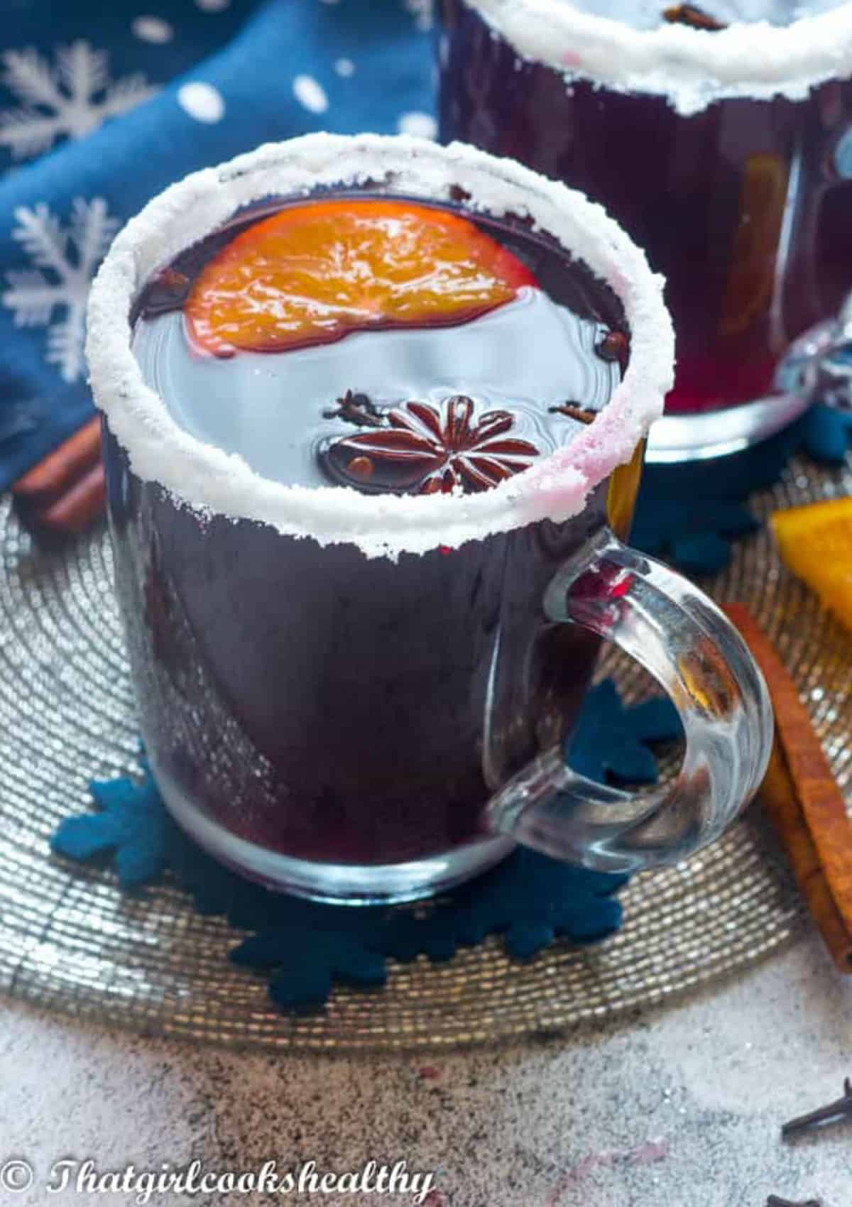 cup of mulled wine with slice of orange and star anise