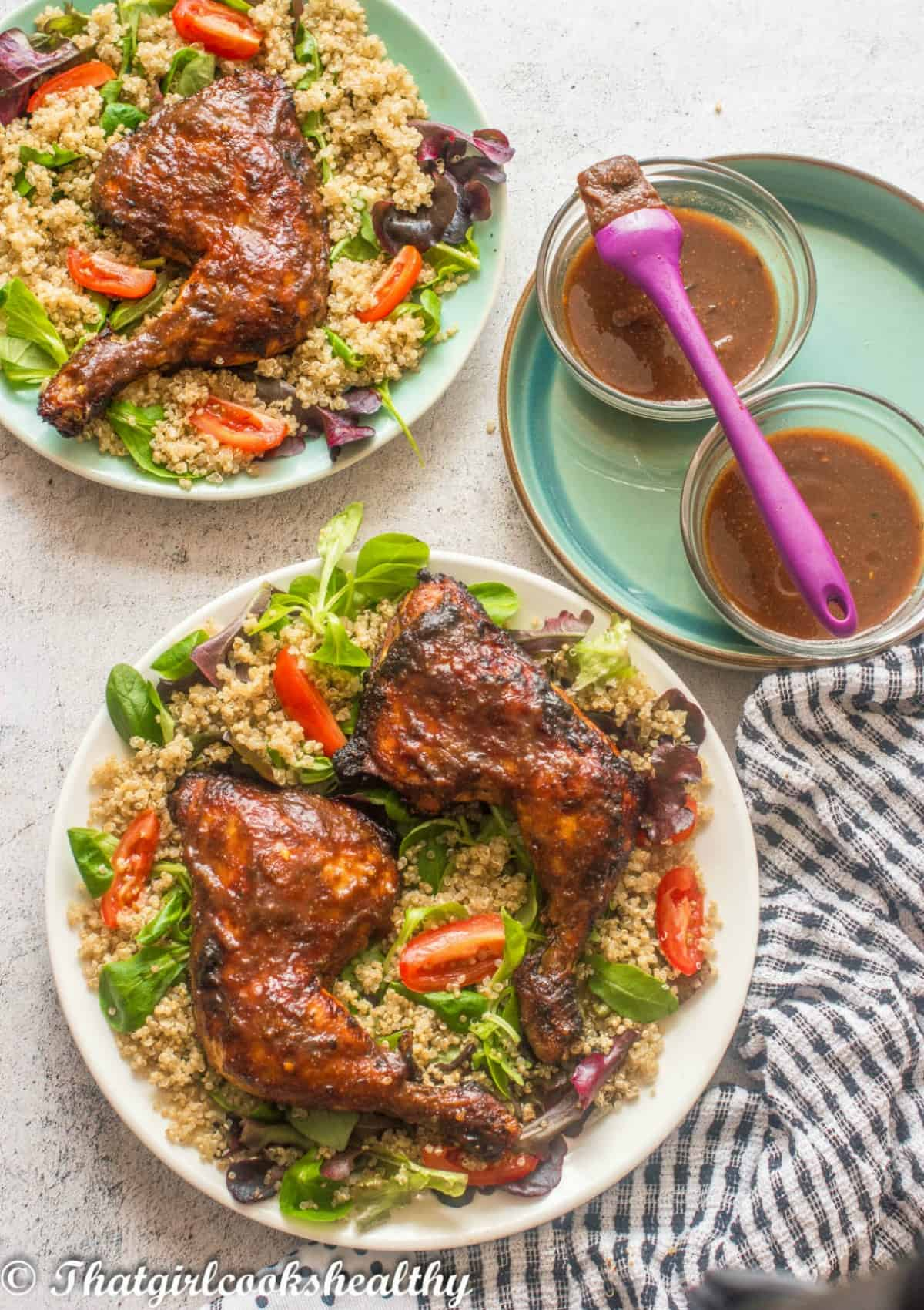 two chicken legs with quinoa