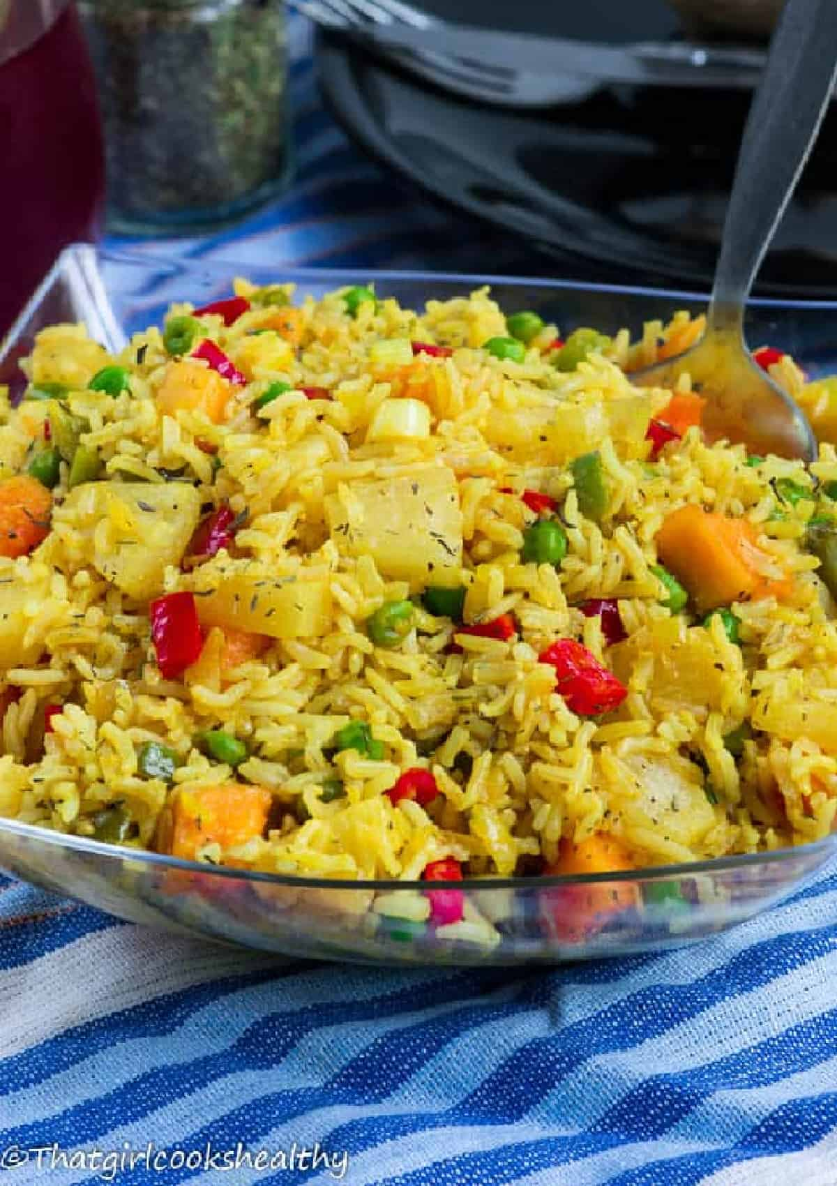 Yellow rice with spoon