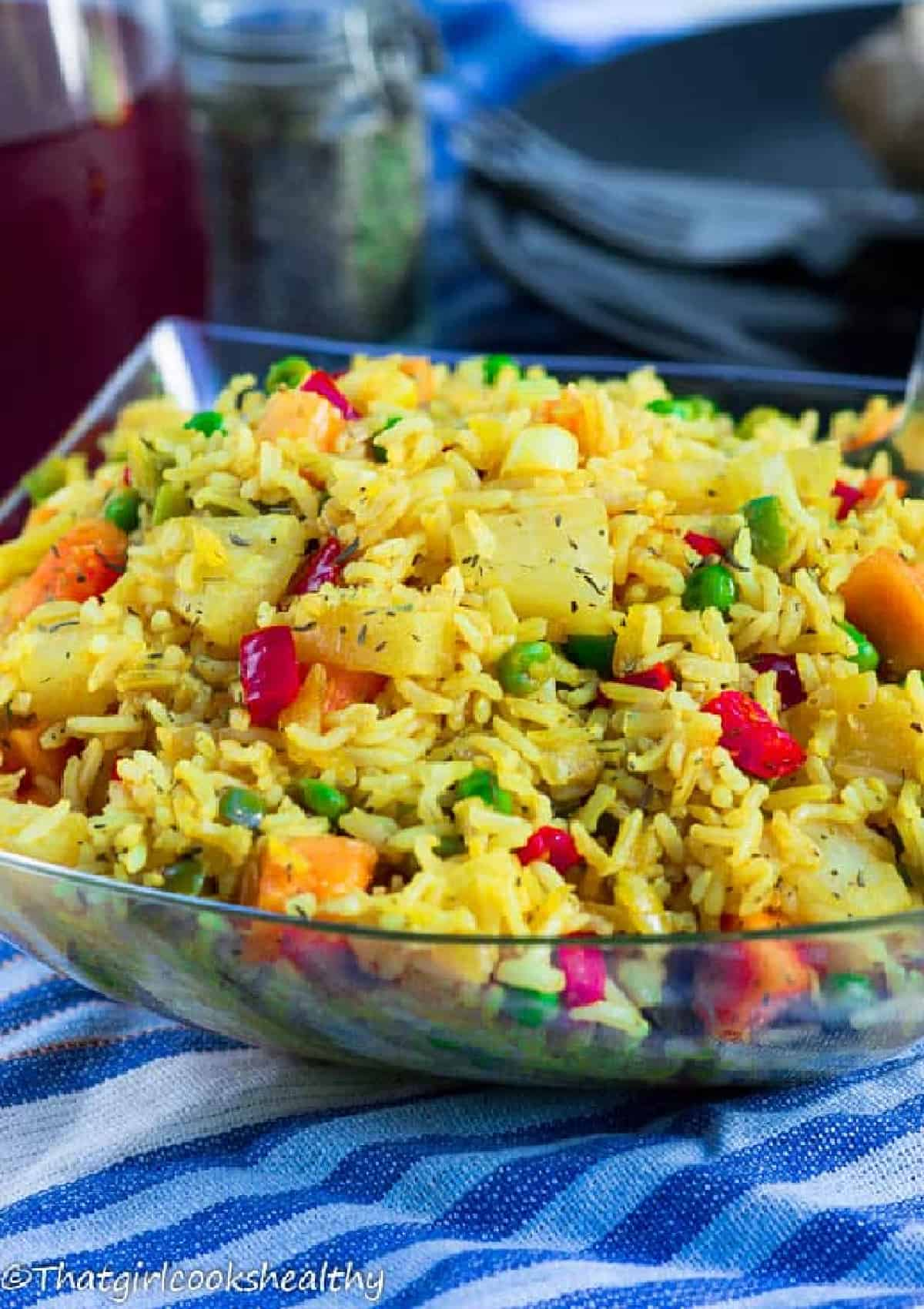 yellow rice in a clear bowl