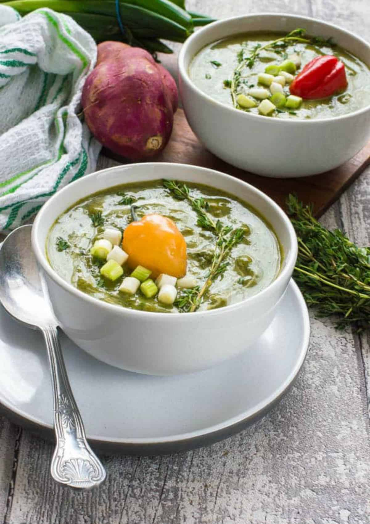 green soup with scotch bonnet on top