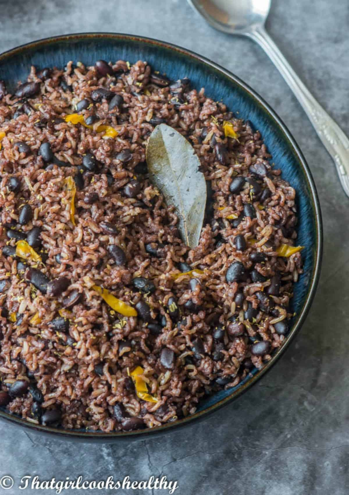brown rice with black beans with a bay leaf