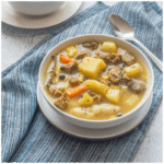 soup with mutton and vegetables in a white bowl