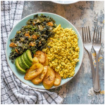 Plate of tofu scramble, green, plantain and avocado