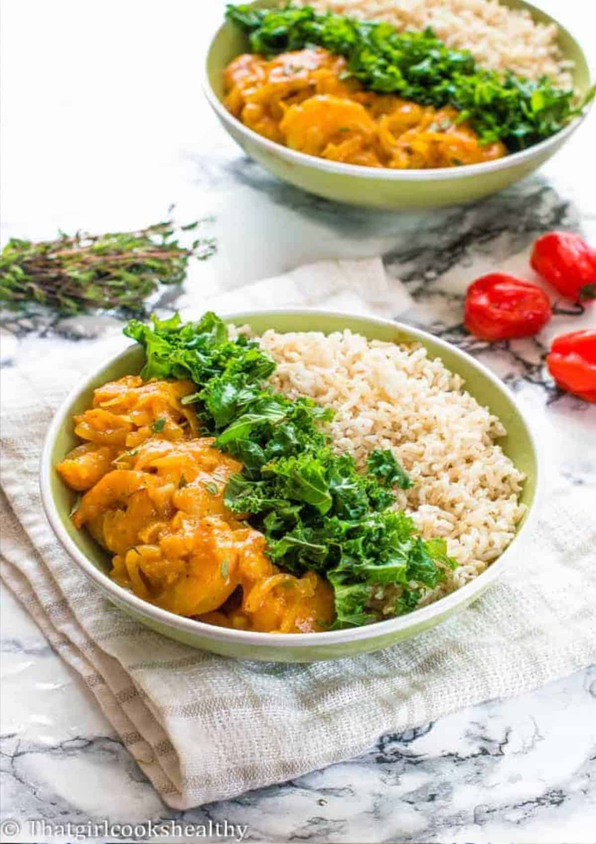 shrimp, kale and rice in a bowl