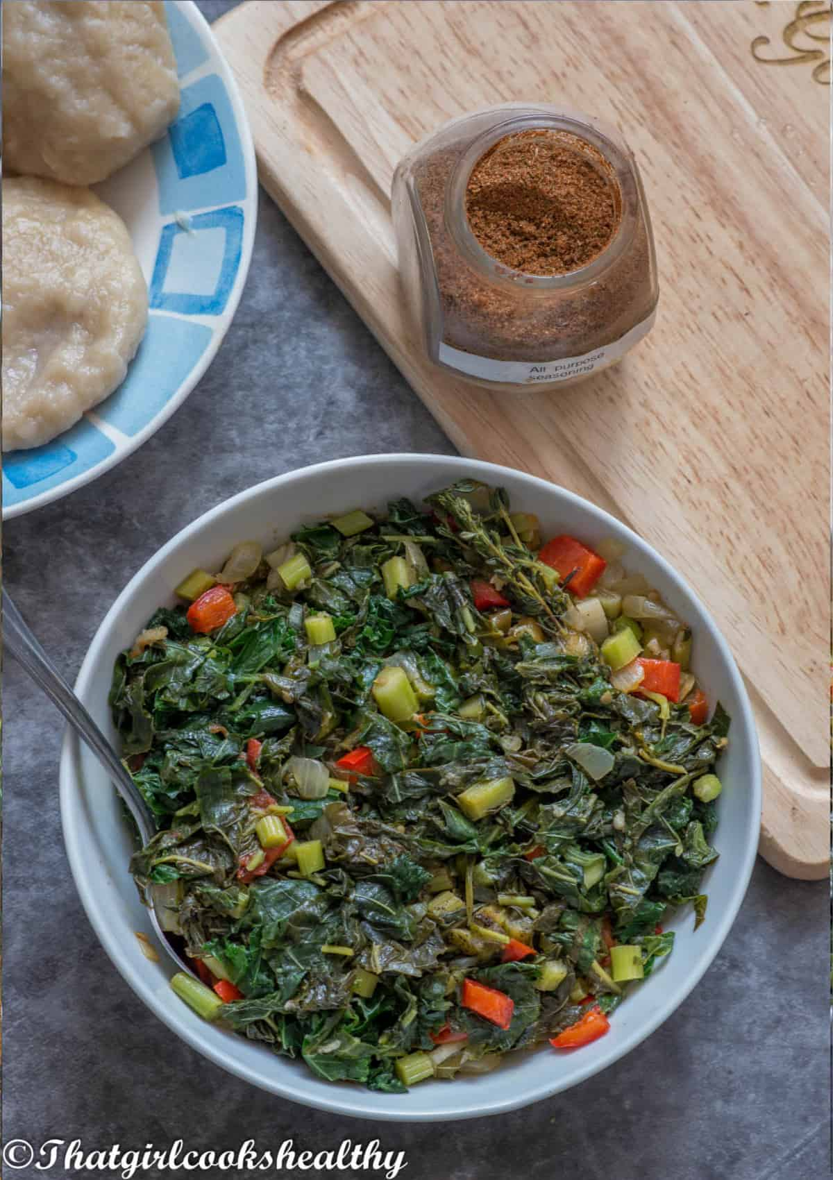 cooked callaloo in a white bowl